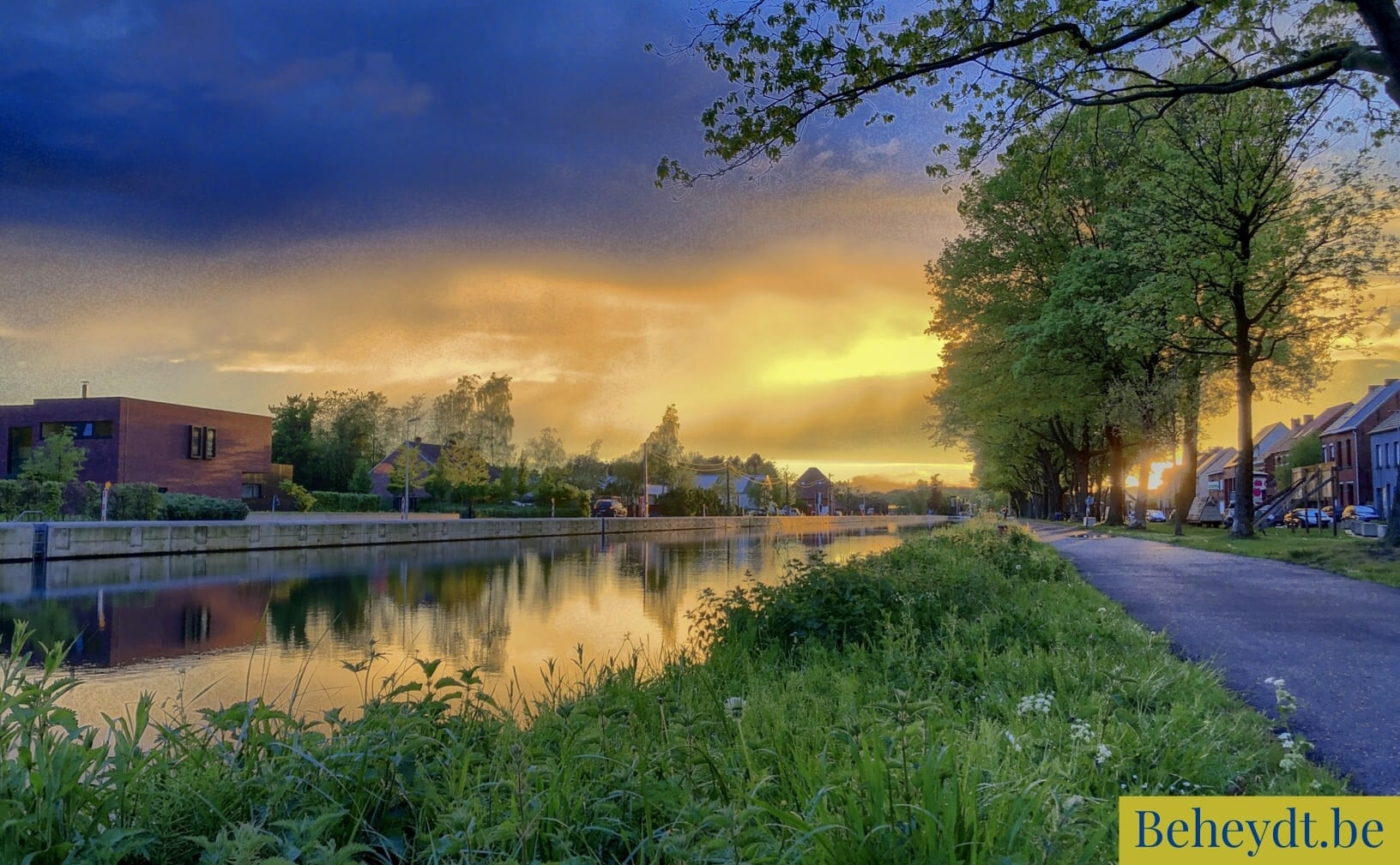 Colorful and dramatic sunrise or sunset over a Countryside river landscape seen from the riverside