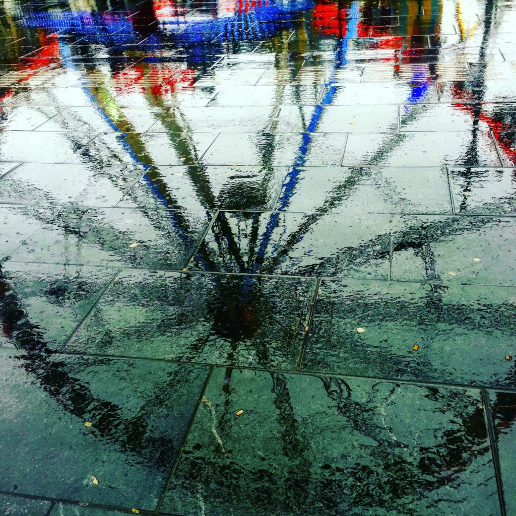 Instead of taking a picture of the ferris wheel, I shot its reflection in the wet street, creating an abstract image with much more impact. Shot on iPhone 6.