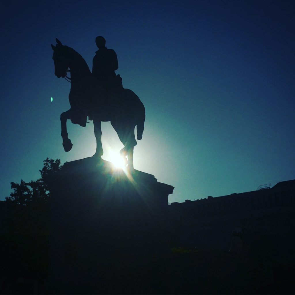 "Using the early morning sun behind this statue, I created a silhouette of the horse and its rider, giving it a mystique touch instead of ""just a picture of a statue"". Shot on iPhone 6."