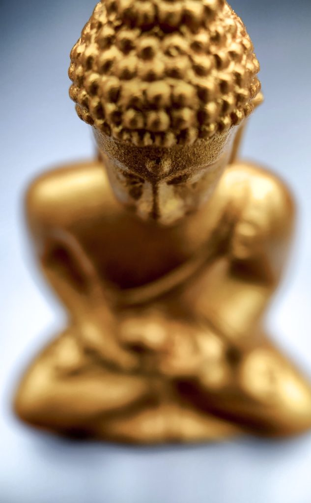 Close up of a golden Buddha, shot on iPhone X with Moment Macro lens.